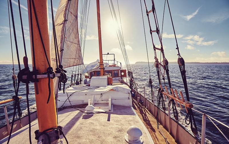 Old sailing ship at sunset.